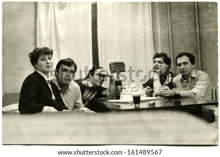 VORONAZH, USSR - 1984: Students of the Faculty of Journalism of the Voronezh State University at a table in a dorm room, Voronezh, Russia, USSR, 1984