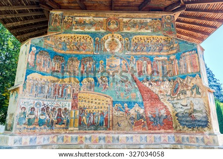 """VORONET, ROMANIA- AUGUST 2015: Last Judgment, Final Judgment, Day of Judgment, or The Day of the Lord fresco on western wall of Voronet Monastery, considered by many the """"Sistine Chapel of the East"""" - stock photo"""