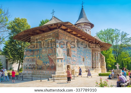 """VORONET, ROMANIA - AUGUST 2015: Voronet Monastery famous for Last Judgment, Final Judgment, Day of Judgment detailed fresco on western wall, considered by many the """"Sistine Chapel of the East"""" - stock photo"""