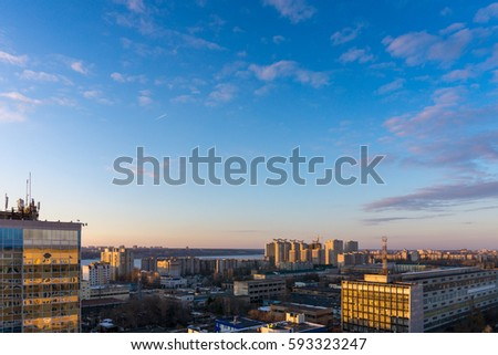 Voronezh cityscape aerial panoramic view from rooftop at sunset time, blue dramatic sky, copyspace