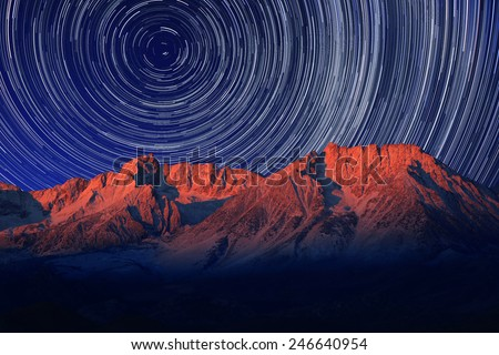 Vortex Night Exposure Star Trails of the Sky in Bishop California - stock photo