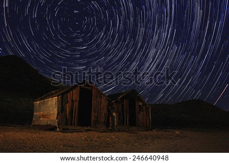 Vortex Night Exposure Star Trails of the Sky in Death Valley California - stock photo
