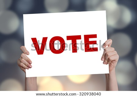 Vote card with bokeh background - stock photo
