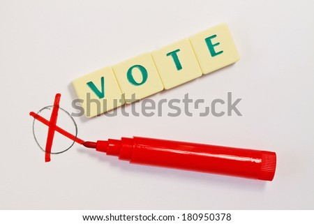 Vote mark and red pen - stock photo