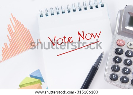 Vote Now - Financial accounting stock market graphs analysis. Calculator, notebook with blank sheet of paper, pen on chart. Top view - stock photo