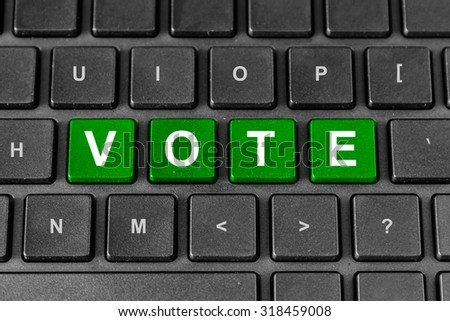 Vote or poll green word on keyboard - stock photo