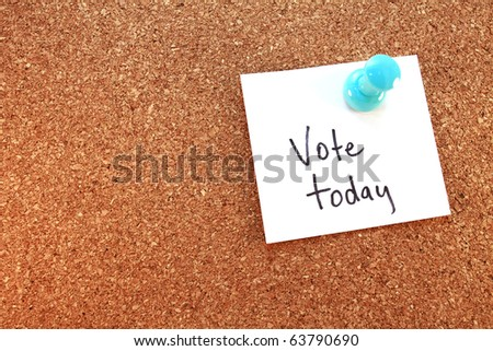 Vote Today A vote today note tacked on corkboard. Horizontal. - stock photo