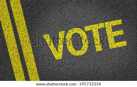 Vote written on the road - stock photo