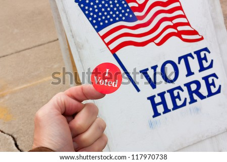 Voter Proudly Displays Evidence that He Voted on Election Day in the United States. - stock photo