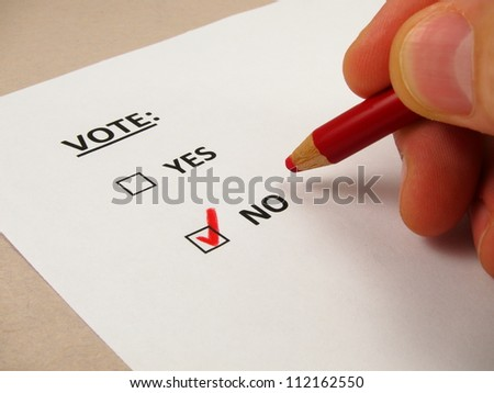 Voting ballot with 'no' box checked - stock photo