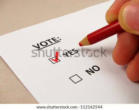Voting ballot with 'yes' box checked - stock photo