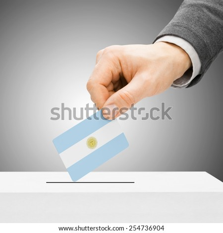 Voting concept - Male inserting flag into ballot box - Argentina - stock photo