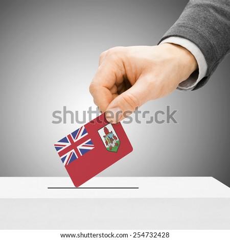 Voting concept - Male inserting flag into ballot box - Bermuda - stock photo