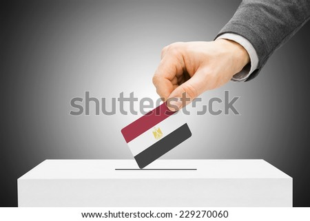 Voting concept - Male inserting flag into ballot box - Egypt - stock photo