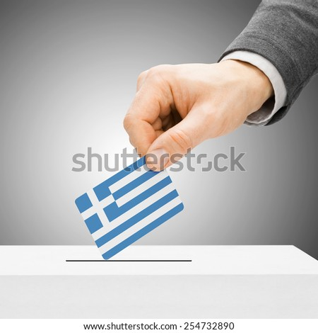 Voting concept - Male inserting flag into ballot box - Greece - stock photo