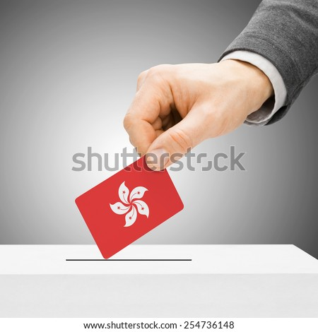 Voting concept - Male inserting flag into ballot box - Hong Kong - stock photo