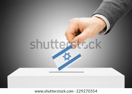 Voting concept - Male inserting flag into ballot box - Israel - stock photo