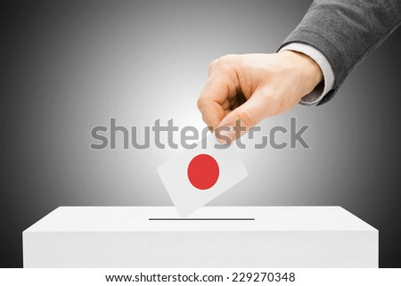 Voting concept - Male inserting flag into ballot box - Japan - stock photo