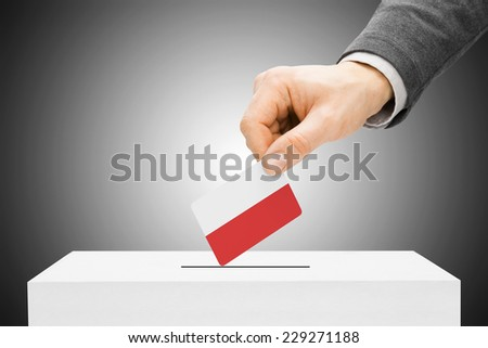 Voting concept - Male inserting flag into ballot box - Poland - stock photo