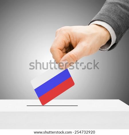 Voting concept - Male inserting flag into ballot box - Russia - stock photo