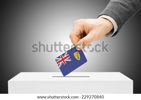 Voting concept - Male inserting flag into ballot box - Turks and Caicos Islands - stock photo
