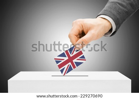Voting concept - Male inserting flag into ballot box - United Kingdom - stock photo