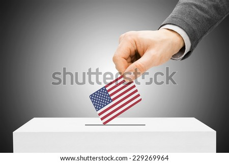 Voting concept - Male inserting flag into ballot box - United States - stock photo