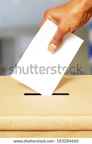 Voting in ballot box - stock photo