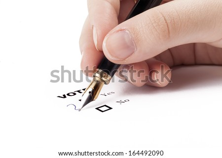 Voting Survey question mark what to choose on white with hand holding fountain pen - stock photo