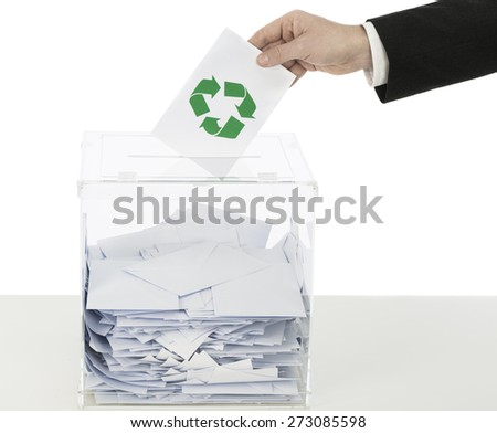 Voting with recycling symbol on voting envelope - stock photo