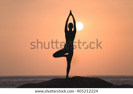 warrior pose yogawoman silhouette stock photo