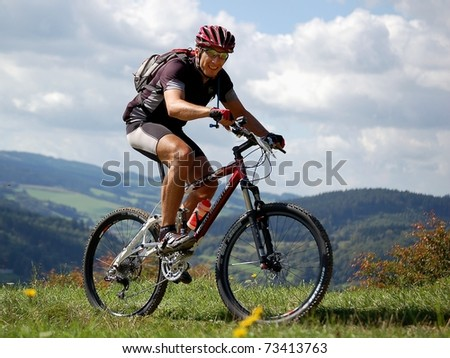 VSETIN, CZECH REPUBLIC - SEPTEMBER 9: Unidentified biker climbs the hill above town of Vsetin in Wallachian 50 Mountain Bike Race, September 9, 2006 in Vsetin, Czech republic. - stock photo