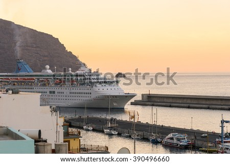 VUELTAS, LA GOMERA, SPAIN - FEBRUARY 03. Early morning the Cruise ship reaches the harbor of Vueltas in the Valle Gran Rey on February 03, 2016. The Cruiser is on round trip to all the Canary Islands - stock photo
