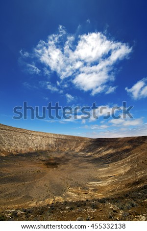 vulcanic timanfaya  rock stone sky  hill and summer in los volcanes lanzarote spain plant flower bush - stock photo