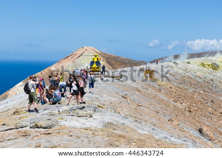 VULCANO, ITALY - MAY 24: Rescue helicopter and people at top of volcano on May 24, 2016 at Vulcano Island near Sicily, Italy
