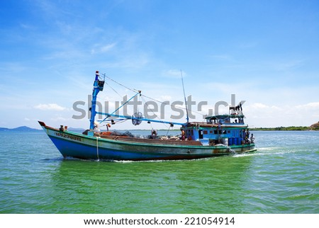 VUNG TAU, VIETNAM - AUG 13: A fishing boat on the sea in Con Dao island. Several countries have made competing territorial claims over the South China Sea on Aug 13, 2014 in Vung Tau, Vietnam. - stock photo