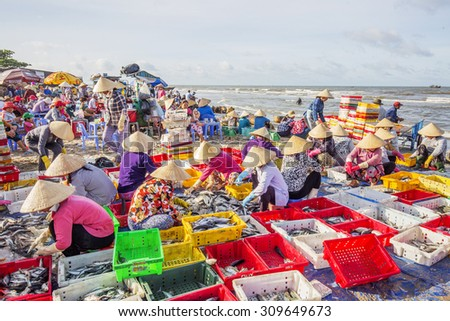 VUNG TAU, VIETNAM - AUG 23,2015: Fishermen on beach at the Fishing Village Long Hai, Vietnam.