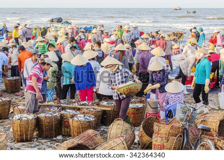 VUNG TAU, VIETNAM - AUG 22,2015: Fishermen on beach at the Fishing Village Long Hai, Vietnam