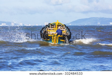 VUNG TAU, VIETNAM - AUG 23,2015: Fishermen on boat at the Fishing Village Long Hai, Vietnam.