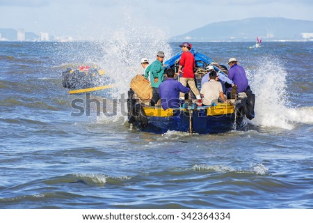 VUNG TAU, VIETNAM - AUG 22,2015: Fishermen on boat at the Fishing Village Long Hai, Vietnam.