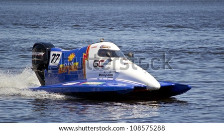VYSHGOROD, UKRAINE - JULY 20 : Powerboat  Team of Clube Interpass F1 fast speed, pilot Matt Paljreyman . Grand Prix Formula 1 H2O World Championship Powerboat on July 20, 2012 in Vyshgorod, Ukraine . - stock photo