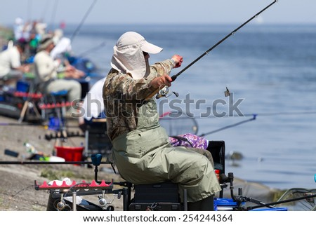 "VYSHGOROD, UKRAINE - JUNE 7, 2014: Fshing competition ""Fishing Feeder Cup of Ukraine"" on the municipal embankment of the Kyiv sea in Vyshgorod , Ukraine  - stock photo"