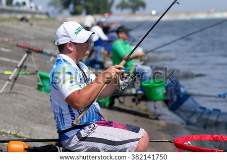 "VYSHGOROD, UKRAINE - JUNE 7, 2014: Fshing competition ""Fishing Feeder Cup of Ukraine"" on the municipal embankment of the Kyiv sea in Vyshgorod , Ukraine ."