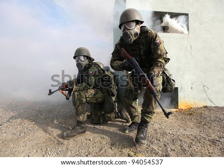 VYSKOV, CZECH REPUBLIC - NOVEMBER 8: A pair of unidentified Czech Republic Army soldiers participate in a Czech Republic Army training session on November 8, 2011 in Vyskov, Czech Republic. - stock photo