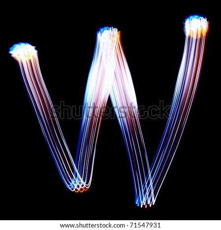 W - Created by light colorful letters over black background - stock photo