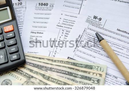 W-9 Form Request for Taxpayer Indentification Number and Certification with dollar - stock photo