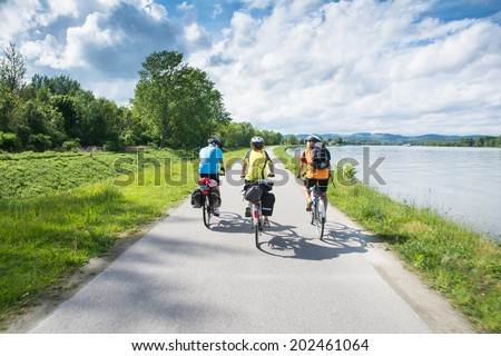 WACHAU VALLEY,AUSTRIA-MAY 9,2014:People are riding bicycle at cycle path near danube river in Austria during a sunny day - stock photo