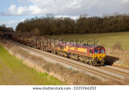 WADBOROUGH, UK - FEBRUARY 27: A DBS operated class 66 diesel locomotive hauls an empty rake of stills wagons toward its south coast depot on February 27, 2014 in Wadborough
