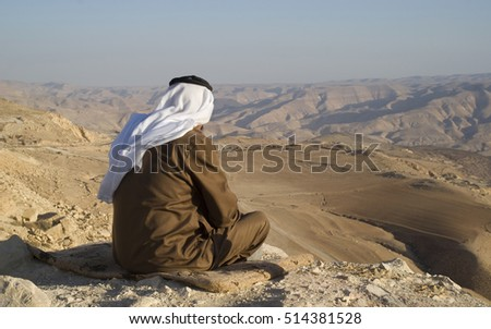 Wadi al Hasa, Jordan - October 25, 2016: A Jordanian senior man enjoy the spectacular views of mountains Wadi Al Hasa in Tafilah Province, Jordan