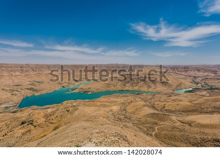 Wadi El Mujib Dam and Lake in Jordan middle east - stock photo